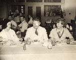Laura Ingalls, Wiley Post, and Amelia eating together