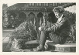 Amelia Earhart sitting next to a fountain