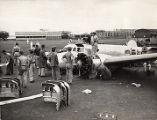 Paul Mantz and others observing the wrecked Lockheed Electra