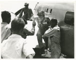 Amelia Earhart assisted off her plane