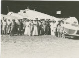 Group of people with Amelia Earhart and Fred Noonan