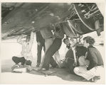 Amelia Earhart with mechanics
