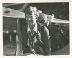 Amelia Earhart in front of the propellers