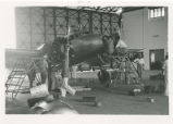 Mechanics performing routine maintenance on the Earhart's Lockheed Electra