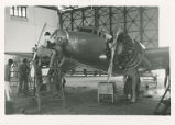Mechanics performing routine maintenance on Earhart's Electra