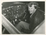 Amelia Earhart in the cockpit of her Electra