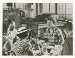 Amelia Earhart, Fred Noonan, and others at a luncheon