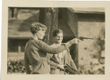 Amelia Earhart shooting guns with Babe Didrikson