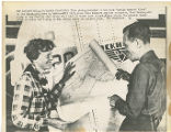 Amelia Earhart and Fred Noonan with map