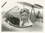 Woman pilot in the cockpit of an airplane