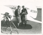 Amelia Earhart and an unidentified man