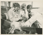Amelia Earhart and two mechanics