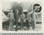 Amelia Earhart with George Palmer Putnam and three men