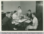 Amelia Earhart with freshman students in home economics