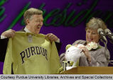 Martin C. Jischke displaying a Purdue sweatshirt
