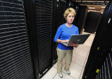 Manager reviewing installation of supercomputer