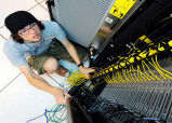 Student installing cabling for supercomputer