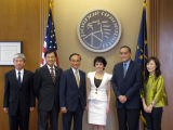 President France Cordova standing with a Taiwanese delegation