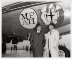 Two men standing in front of Midwest Program on Airborne Television Instruction (MPATI) airplane