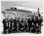 Men standing in front of Midwest Program on Airborne Television Instruction (MPATI) airplane