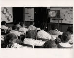 School children watching a television show broadcast by MPATI