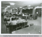 Men seated in dining room of residence hall