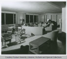 People seated in lounge of residence hall