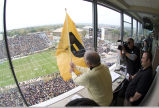 Neil Armstrong waving Purdue flag at homecoming football game