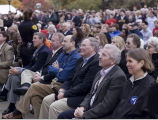 Astronauts seated in audience during building dedication