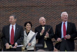 Astronauts and Purdue administrators holding ceremonial scissors