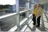 William Bindley and wife standing in Bindley Bioscience Center walkway