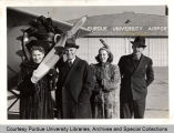 Visitors at Purdue airport, standing in front of airplane