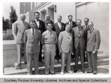 Group of men posing in front of Purdue building