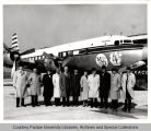 Group of people in front of airplane
