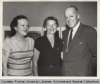 President Hovde standing with two women