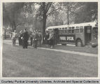 President Hovde and others in front of bus