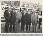 President Hovde and others in front of sign