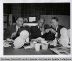 Harry Reed, Fred Hovde and Frank Hockema seated, smoking pipes