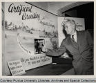 Ed Gannon in front of agricultural exhibit