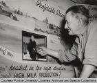 Earl Stichter in front of dairy exhibit