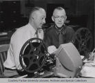 Two men looking at 4-H film