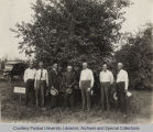 President Elliott and others standing in front of original Turley apple tree