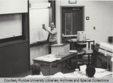 Herb Moskowitz speaking and gesturing in classroom