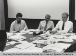Dean Weidenaar and others working at table