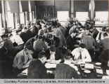 Men studying in agriculture lab