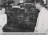 Men standing in front of scientific equipment