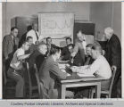 Group of men gathered around table