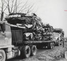Demolished cars on truck beds