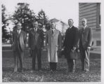 Edward C. Elliot standing with four other men