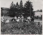 Professor and students examining plants outside